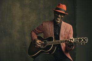 Kevin Roosevelt Moore (Keb Mo) playing guitar